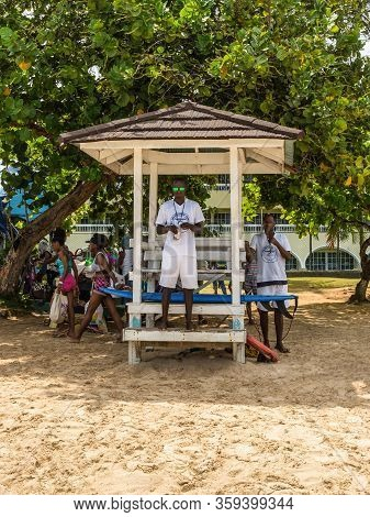 Ocho Rios, Jamaica - April 22, 2019: The Ocho Rios Bay Beach With Lifeguards And People Relaxing On