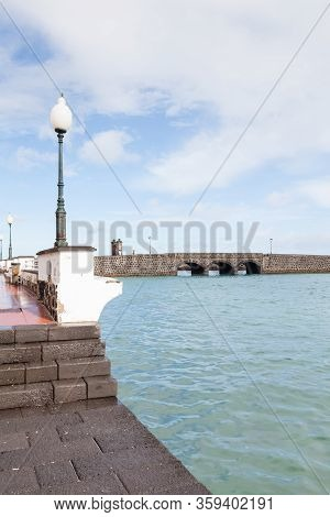 Arrecife Waterfront.  The View From Arrecife Waterfront Looking Towards A Bridge, On The Island Of L