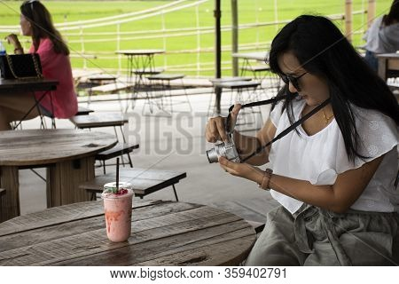 Travelers Thai Woman Blogger Take Photo Strawberry Yogurt Frappe In Plastic Cup For Writing Travel B
