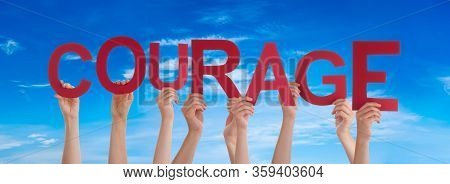 People Hands Holding Word Courage Means Do Not Give Up, Blue Sky