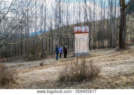 Ruzomberok, Slovakia - April 3, 2020: Praying Senior In Front Of Chapel At Calvary Due Coronavirus C