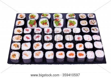 Maki Sushi Set Rolls With Fresh Ingredients. Rolls On Black Stone Isolated On White Background. Sush