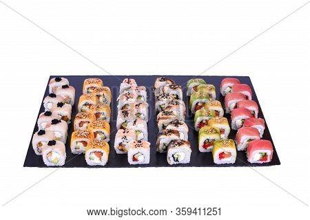Sushi Set Dragon Rolls With Fresh Ingredients On Black Stone Isolated On White Background. Sushi Men