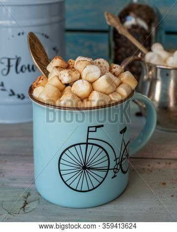 Coffee With Generously Sprinkled Marshmallows And Chocolate Closeup On A Wooden Table