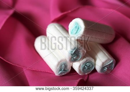 Women's Sanitary Tampons On A Pink Dress, Hygiene Products.