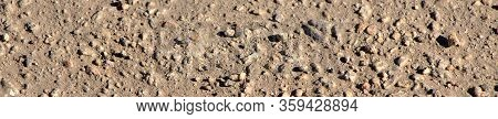 Background Of Asphalt On The Screen Saver. Texture Of Small Stones, Road Surface.