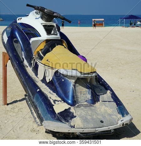 Dirty Old Jet Ski Parked On The Beach Of Holiday Season. Old Jet Skis On The Beach On Wooden Trailer