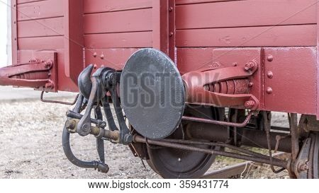 Old Train Carriage On Rails, Red Wooden Train Carriage. Old Style Hook Railway Coupling And Buffers