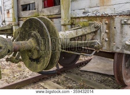 Old Train Carriage On Rails, White Wooden Train Carriage. Old Style Hook Railway Coupling And Buffer