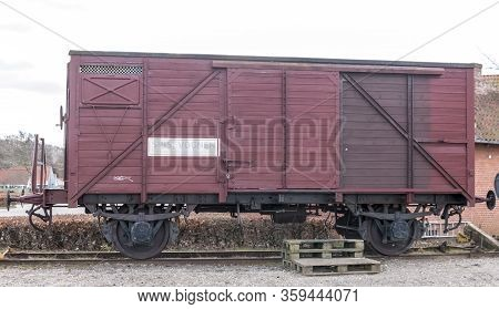 Mariager, Denmark - 29 March 2020: Old Train Carriage On Rails, Red Wooden Train Carriage