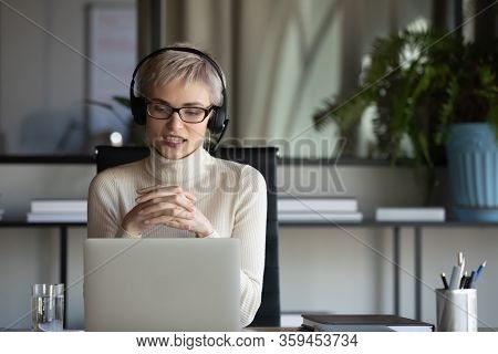 30s Businesswoman Holding Video Call Negotiations Meeting Online.