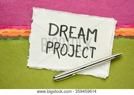 dream project - handwriting on a handmade paper against colorful abstract landscape, creativity and personal development concept