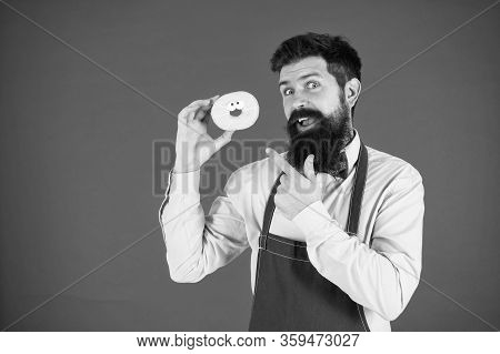 Cheat Meal. Hipster Bearded Baker Hold Glazed Donut On Red Background. Cafe And Bakery Concept. Swee