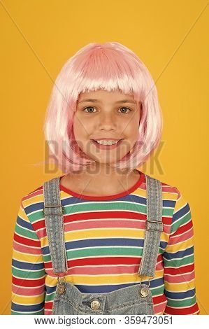 New Smile New Look. Little Girl Smile In Short Pink Hair Wig. Happy Child Smile Yellow Background. S