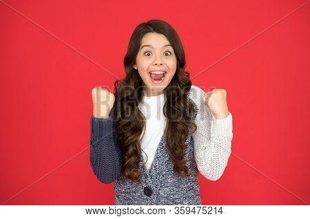 What Real Winner Looks Like. Happy Winner Red Background. Small Girl Make Winner Gesture. Celebratin