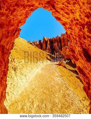 Arch Opening In The Vermilion Colored Hoodoos On The Navajo Trail In Bryce Canyon National Park, Uta