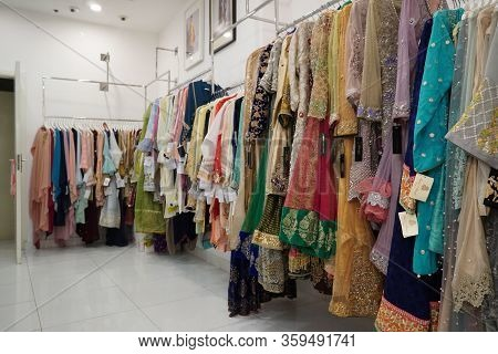 Close Up Colorful And Shinny Indian Bridal Wedding Dress In A Shop. Female Party Clothes. Indian Par