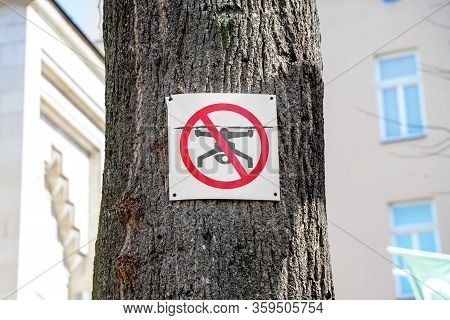 Prohibition Sign That Drones Cannot Be Used In This Area Is Hanging On Tree In City. Modern Technolo