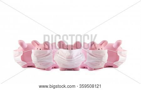 Group of pink piggy banks with protective medical masks on white background. Banking during a pandemic concept.