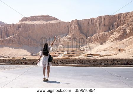 Young Brunette Female In White Dress Walks In Front Of Part Of The Mortuary Temple Of The Queen Hats