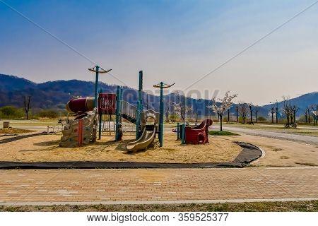 Sejong, South Korea; April 1, 2020: Playground Equipment Sitting Unused In Vacant Rural Public Park.
