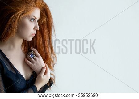 Close-up Portrait Of A Beautiful Sad Young Woman Looking Away.