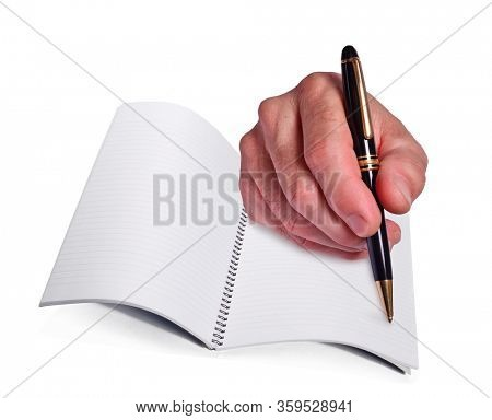 Male hand holding a pen writing on white notebook