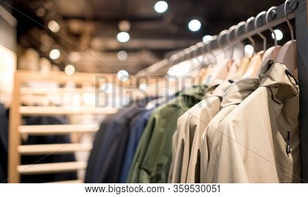 Modern Fashion Women Clothes Hang On Stanless Steel Hangers Rack At Clothing Store Department Store.