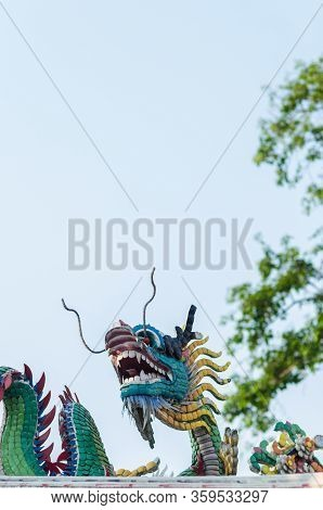 Chinese New Year Dragon Decoration On Blue Sky Background.chinese Sculpture Designs.dragon Head.happ