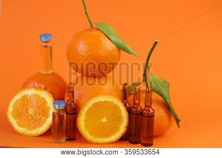 Vitamin C Prevention Of Immunity From Viruses.vitamin C Set Of Ampoules And Fresh Oranges And Mandar