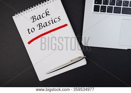 The Text, The Inscription, The Phrase Back To Basics Is Written In A Notebook That Lies On A Dark Ta