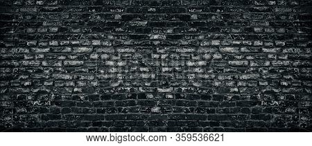 Old Black Shabby Brick Wall Wide Texture. Aged Dark Brickwork With Peeling Paint. Gloomy Grungy Wide