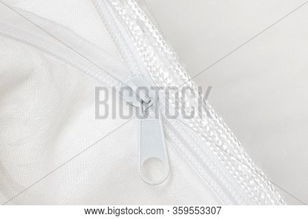 Silk Blanket For A Comfortable Sleep. White Blanket Folded On A White Background. Fabric Structure.