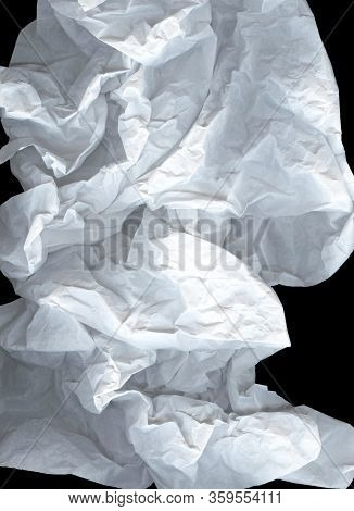 Large Light Elegant Cloud Of Crumpled Paper On A Black Background. White And Gray Wide Crumpled Pape