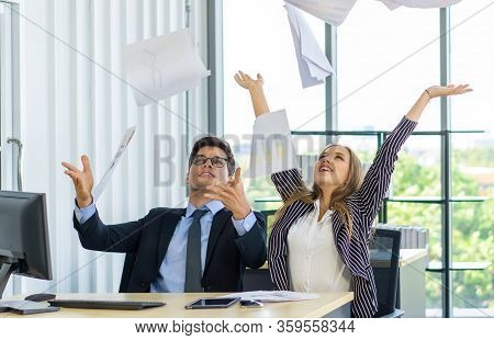 The Young Manager In The Suit And The Secretary Threw The Work Documents Into The Sky After Hearing