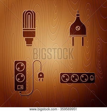 Set Electric Extension Cord, Led Light Bulb, Electric Extension Cord And Electric Plug On Wooden Bac