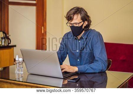 Coronavirus. Man Working From Home Wearing Protective Mask. Quarantine For Coronavirus Wearing Prote