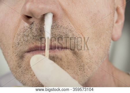 Taking A  Virus Test Sample From A Nose