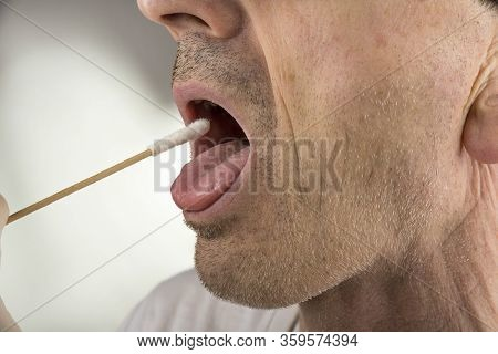 Taking A  Virus Test Sample From A Throat