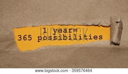 Text Appearing Behind Torn Red Envelop - 1 Year, 365 Possibilities. Motivational Concept