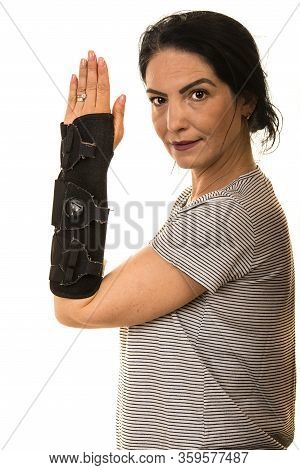 Woman Showing Hand In Orthosis Isolated On White Background