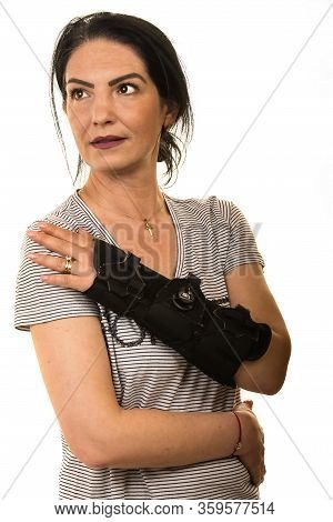 Woman With Hand Orthosis Looking Away Isolated On White Background