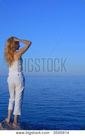 Beautiful Young Woman Looking At The Sea