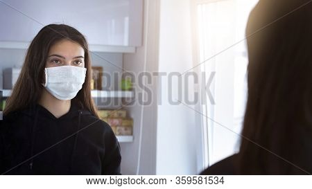 Sadness Young Teenage Girl In Medical Facemask Looking In Mirror In Your Face