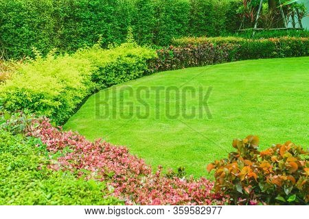 Landscaped Formal, Front Yard With Garden Design, Green Lawn, Garden Design, Landscaping In The Gard