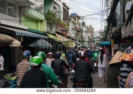 Ho Chi Minh, Vientam - August 25, 2017: Ho Chi Minh City Street With People On Their Motorcycles Dri