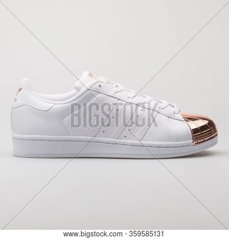 Vienna, Austria - August 6, 2017: Adidas Superstar Metal Toe White And Rose Sneaker On White Backgro