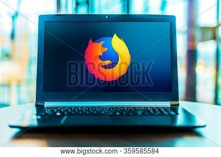Poznan, Pol - Mar 24, 2020: Laptop Computer Displaying Logo Of Firefox, A Free And Open-source Web B