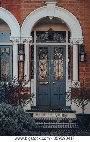 London, Uk - March 22, 2020: Stained Glass Wooden Door Of A Traditional Victorian House In London, U