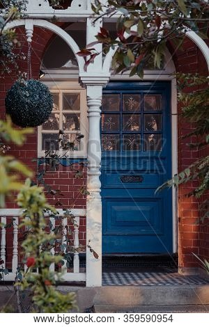 London, Uk - March 22, 2020: Stained Glass On A Blue Wooden Door Of A Traditional Victorian House In